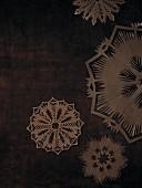 Stencils on brown background