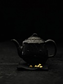 Black teapot with gold