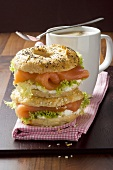 Poppy seed & sesame bagels filled with smoked salmon & cream cheese