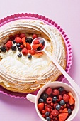 Pastry ring filled with berries and coconut yoghurt