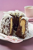 Marble cake with chocolate icing and white chocolate shavings