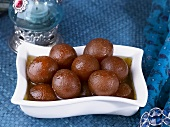 Gulab jamuns (Deep-fried milk balls in syrup, India)