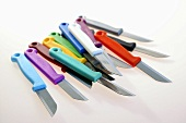 Kitchen knives with different coloured handles