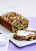 Fruit loaf with nuts and slivered almonds