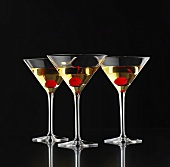 Three Martinis with cocktail cherries