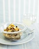 Fruit muesli in glass bowl