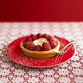 Lemon meringue tart with raspberries