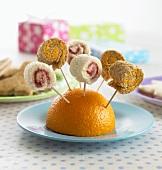 Pinwheel sandwiches on cocktail sticks in half an orange