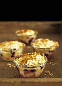 Apple and berry crumble in glass dishes