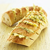 Garlic baguette with cheese and herbs