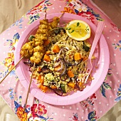 Chicken skewers and couscous with butternut squash (overhead view)