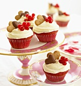 Red velvet cupcakes with redcurrants