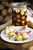 Sweet and sour pickled onions with ham and baguette