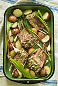 Marinated lamb chops with vegetables in a roasting dish