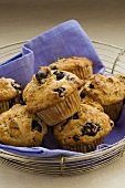 Several blueberry muffins in a wire basket