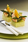 Prawn and asparagus salad on squares of melon