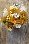 Noodles, pulses and rice in paper bags