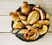 Pretzel rolls, bread rolls and croissants in bread basket