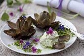 Baby artichokes with herb cream and violets