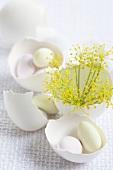 Sugar eggs and dill in eggshells