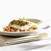 Cod with herb crust on tomato risotto