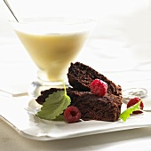 Milkshake and chocolate cake with raspberries