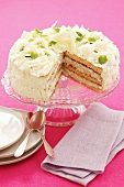 Coconut cake with white chocolate, a piece removed