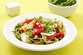 Green tagliatelle with grilled peppers, rocket and goat's cheese