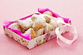 Almond crescents with icing sugar in box