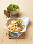 Apricots with goat's cheese, salad leaves, whole grain bread