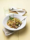 Rye pasta with sprouts and button mushrooms