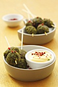 Spinach balls with yoghurt dip