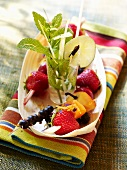 Fruit skewers with fresh mint