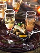 Spring rolls and sparkling wine cocktails