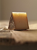 Piece of Basque cheese on linen cloth