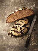 Rye bread, halved, with bread knife