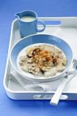 Porridge with fruit on tray