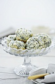 Lemon and poppy seed muffins on cake stand