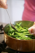 Sweating green beans in copper pan