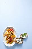 Braised summer vegetables with ricotta and basil crostini