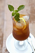 Ginger iced tea drink with cachaca and mint (South Africa)
