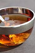 Black tea with sugar crystals