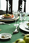 Fruit and plates on laid table