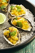 Oysters with mango salsa on ice