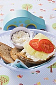 Cottage cheese, cucumber and tomato slices on bread