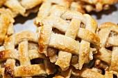 Apple and raisin lattice tarts