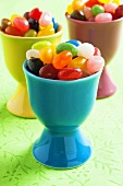 Coloured jelly beans in egg cups