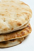 Several naan breads, stacked