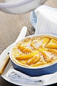 Sprinkling peach pie with icing sugar