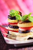 Towers of aubergine, polenta, tomato and basil